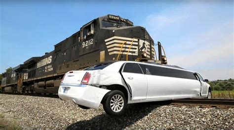 Yikes! Watch Train Crash Into Stuck Chrysler Limo In