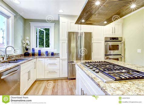 kitchen island  built  stove granite top  hood