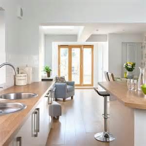 House To Home Kitchen pale grey kitchen with oak effect floor kitchen