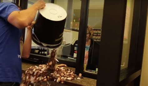 man pays  speeding ticket   pennies