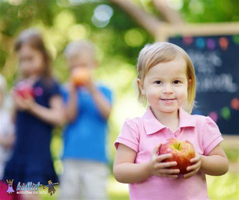 what to look for in a preschool kidlist activities for 720 | Preschooler Holding Apple