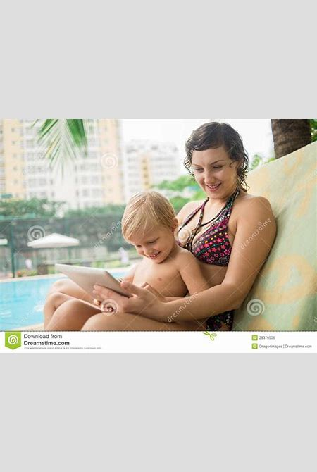 Mom, son and touchpad stock photo. Image of portable - 28376506