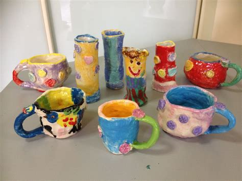 kids pottery coil mugs  slab vases decorated