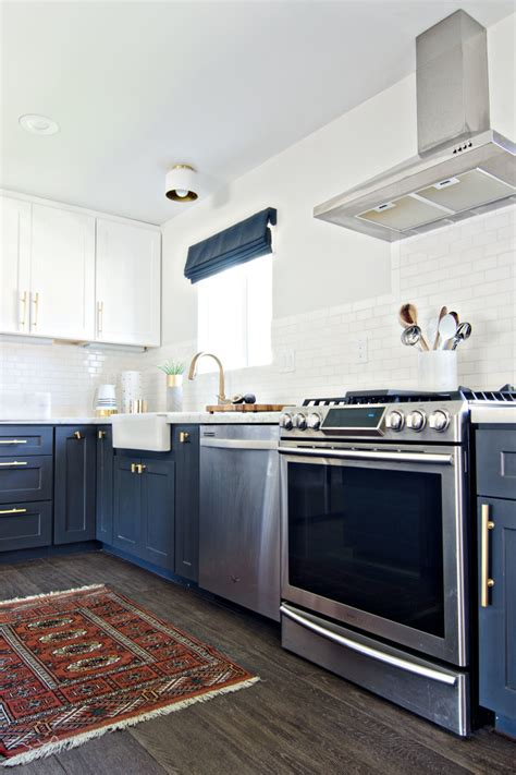 white and navy kitchen cabinets navy gold white kitchen reveal the vintage rug shop