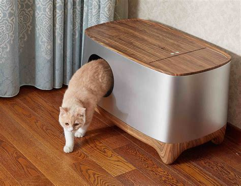 Auto Litter Box by This Self Cleaning Litter Box Automatically Packs Pet Waste