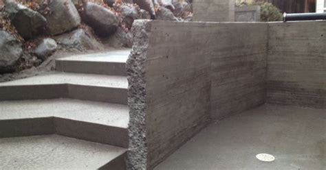 deconstructed granite quot deconstructed quot board formed concrete wall acid washed concrete stairs and pad design by