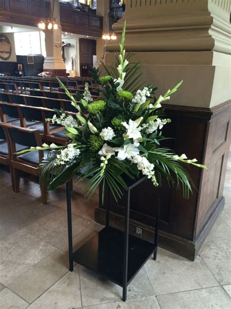 pedestals floral decorators instagram church pedestal flower arrangement church flowers