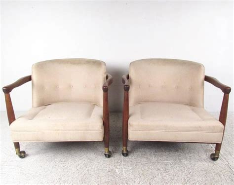 Stylish Pair Of Vintage Modern Rolling Armchairs For Sale