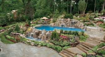 Pool And Waterfall Installation And Landscaping Design Ideas Saddle Amazing Tropical Garden And Pool Inspired Design Elements From Bali Garden Friendly Pools Pool Has Been Designed With The Hot Tub Spilling Over Into The Pool
