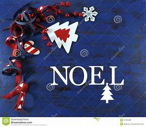 christmas background with felt decorations on dark blue With noel letters for christmas
