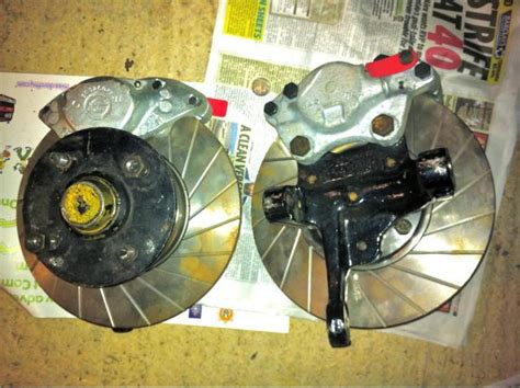 Ford Cortina uprights , discs and hubs..