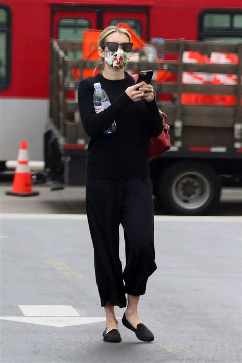 emma roberts dresses in all-black while making a coffee ...