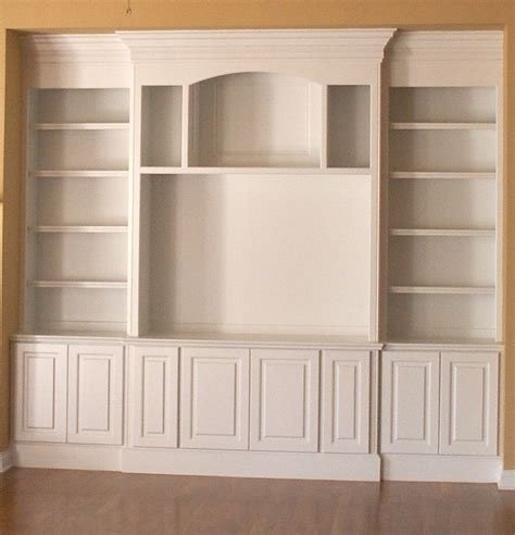 how to build a built in bookcase with doors built in bookshelf design plans woodworktips