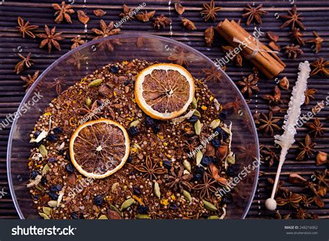 Rooibos Tea With Two Dry Orange Slices In Plate On Dark