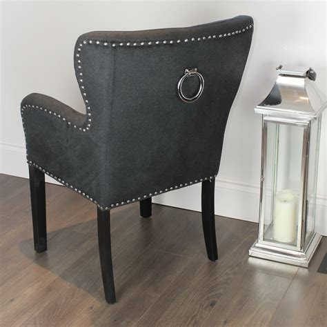 black studded dining chair with arms silver ring