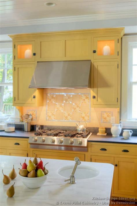 traditional yellow kitchen   custom wood island