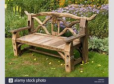 Ornate, rustic, wooden garden bench seat made from