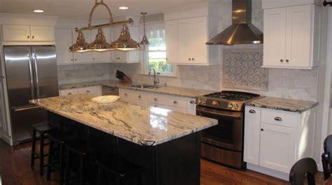 love  silver cloud granite  white cabinets
