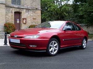 Red Peugeot 406 Coupe