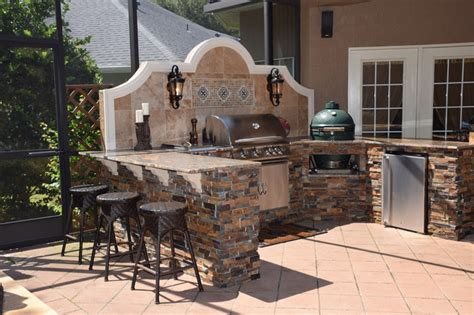 Outdoor Kitchen With Big Green Egg, Gas Grill And Bar Seating