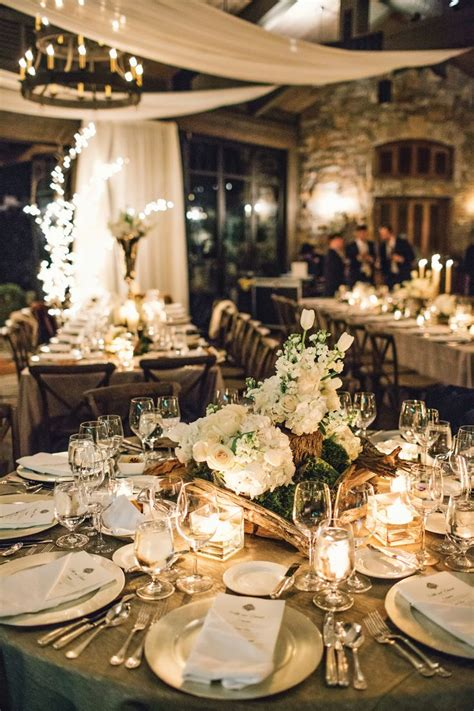 White And Silver Wedding Reception Table With Silver