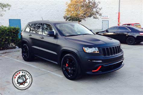 matte black jeep jeep srt8 wrapped in 3m deep matte black wrap bullys