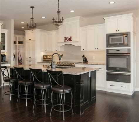 white kitchen with black island maple painted white black schmidt custom cabinetry