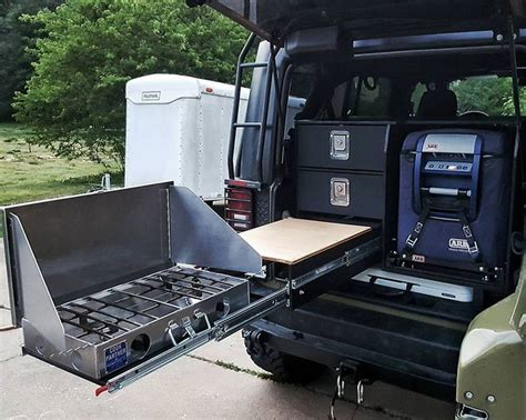 Man's compact DIY camping kitchen system means better off