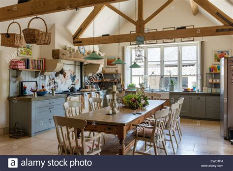 vintage farmhouse table in rustic kitchen with green pendant lights stock photo 84494680 alamy