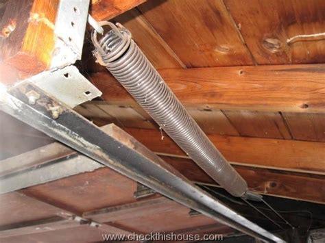garage door springs safety avoiding  injury