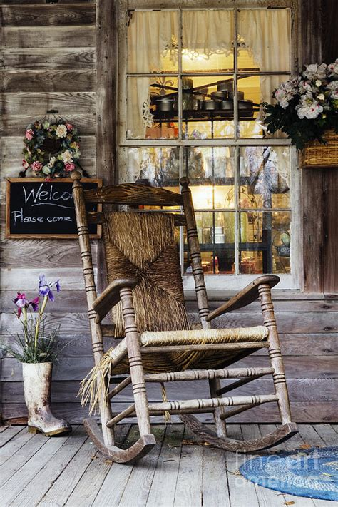 wooden rocking chair on a wooden porch by woodhouse