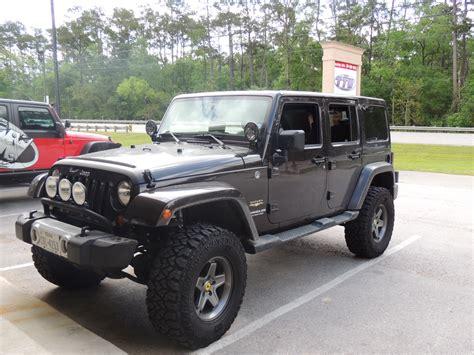dark brown jeep jeep jk unlimited 4x4 with aev wheels texas truck works
