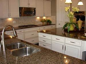 Brown granite in a beautiful white kitchen in a model home ...