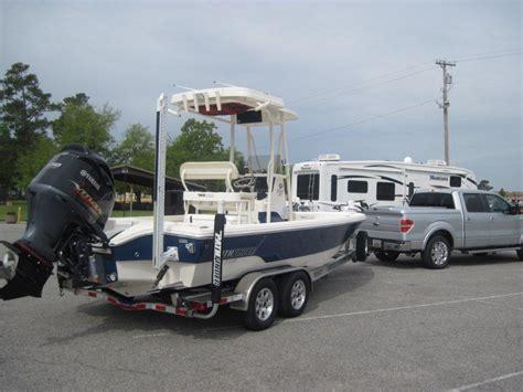 Contender Boats Vs Everglades by Everglades 243cc Vs Contender 25 Bay Vs Pathfinder 2600