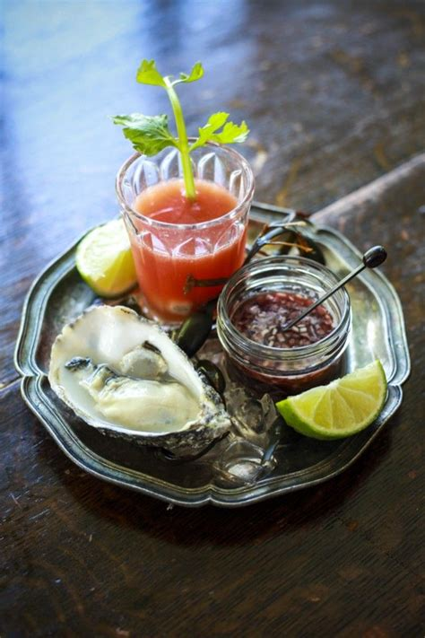 mignonette cuisine bloody oyster shooters with oysters and a shallot