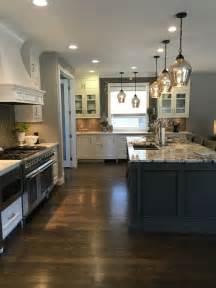 white cabinets granite island dark wood floor gray glazed island kitchen islandpendant lig
