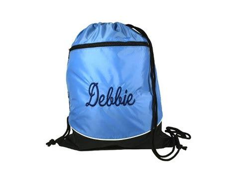 blue monogrammed drawstring backpack front zip pocket