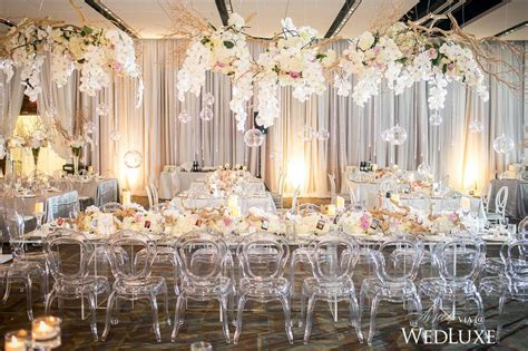 elegant wedding place decor with florist and lighting