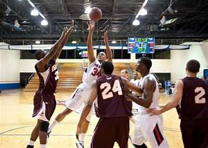 The Patriot : FMU men's basketball team marches over ...