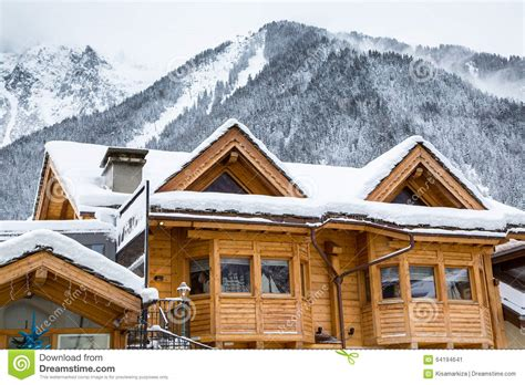 snow covered chalet   mountains editorial photo