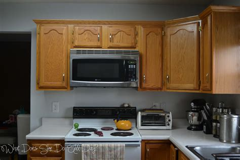 gray painted kitchen cabinets before and after grey wall with white cabinets and warm brown chairs crisp