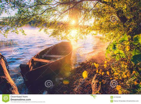 boat  lake sunrise stock photo image  boat float