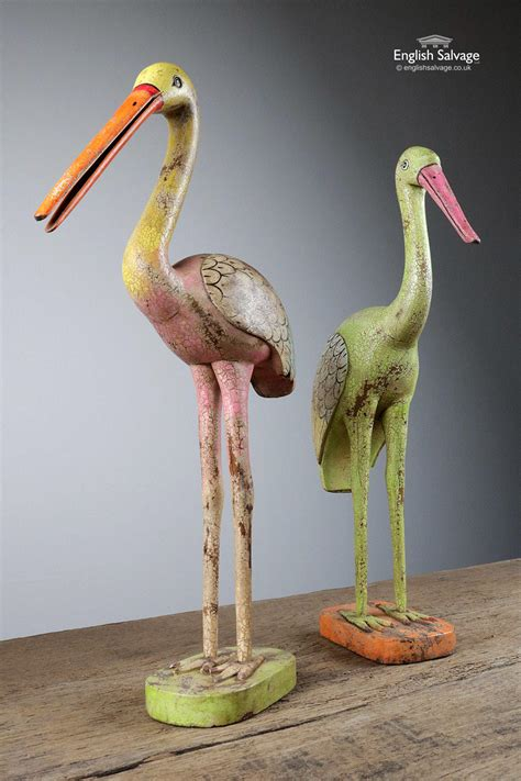 colourful hand carved wooden bird statues