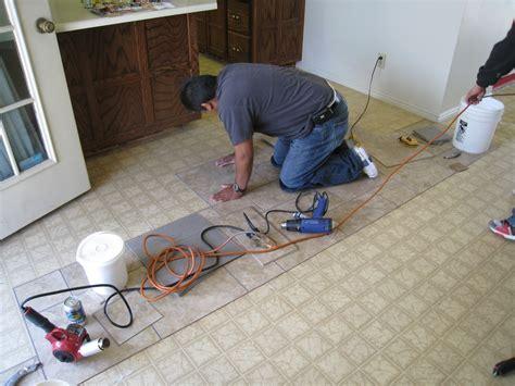 Laying Tile Linoleum Concrete by Installing A Permastone Modular Vinyl Tile Floor