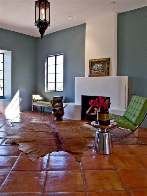 terracotta floor tile living room eclectic with tin pendant themed decorative pillows