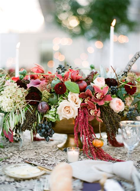 fall themed centerpiece  roses  amaranthus