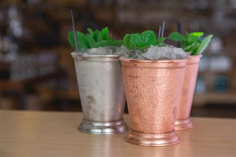 mint julip sip on southern tradition with a classic mint julep behind the bar