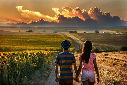 Couple Holding Hands Road Field Sunflowers Clouds