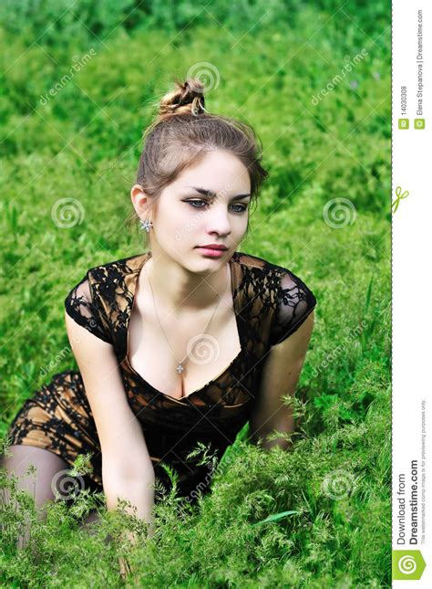 Awesome Girl Sitting In The High Grass Royalty Free Stock