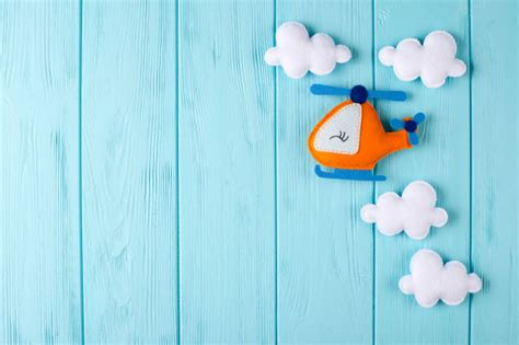 orange craft helicopter  clouds  blue wooden